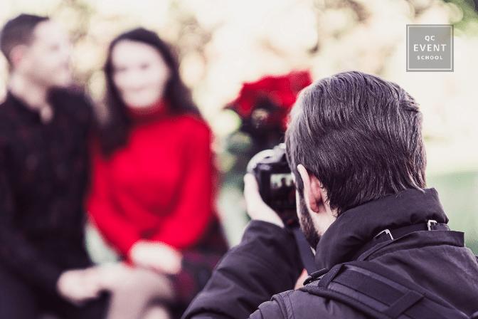 Photographer taking photos of couple