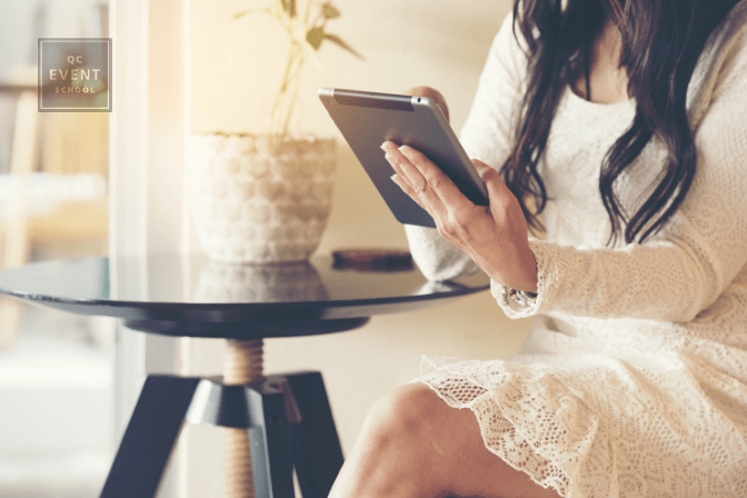 woman sitting at desk and scrolling on iPad
