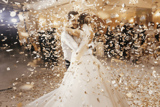bride and groom dancing amidst lots of golden confetti