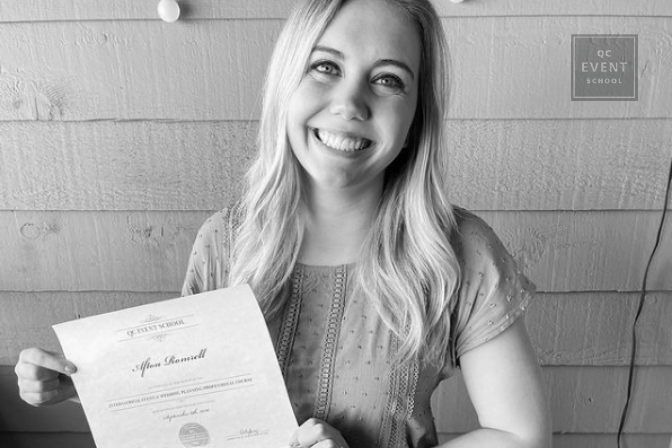 Afton Romrell proudly holding up her event planning certification from QC Event School