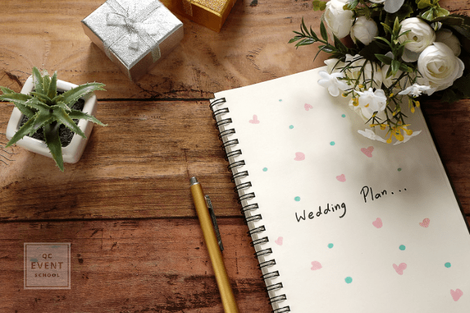 wedding planning notebook and plants on table