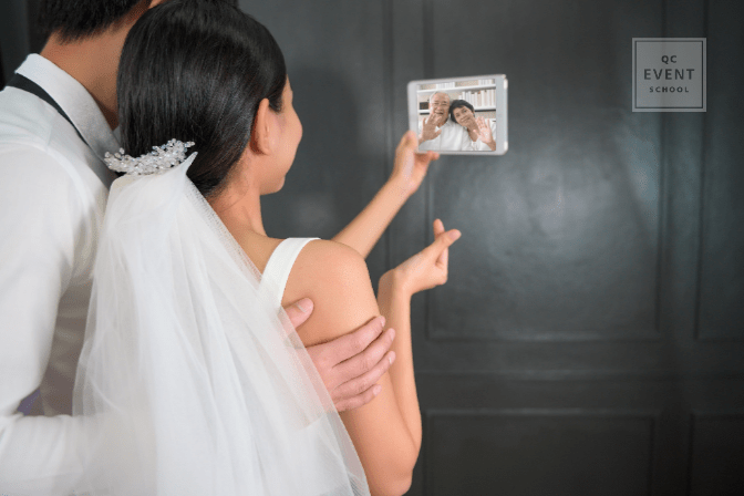 bride and groom on video call with elderly relatives