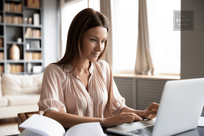 woman working on laptop at desk from home
