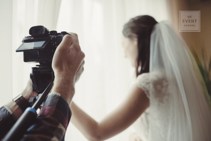 wedding planner certification article third in-post image, videographer recording bride