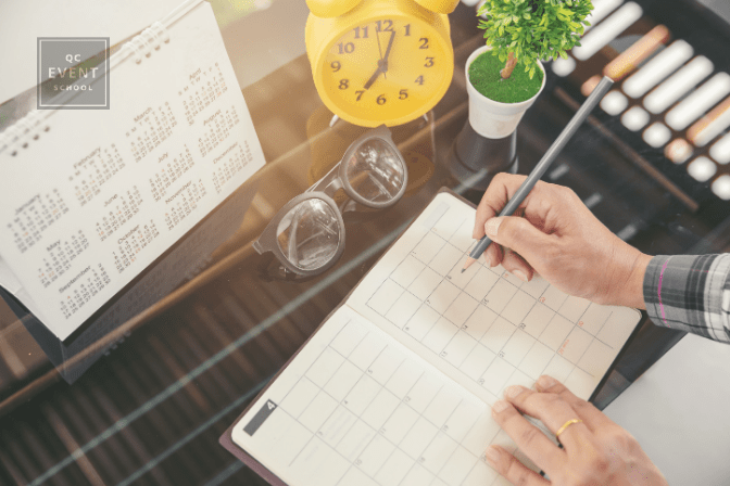 Professional writing in planner on table
