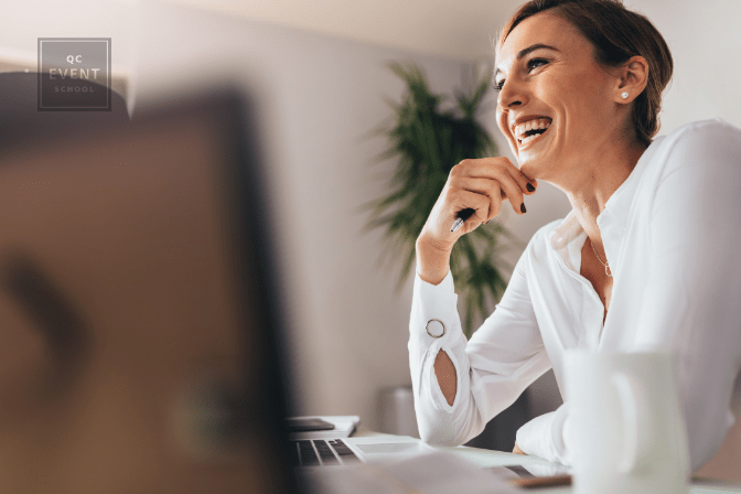 Event planning classes article, first in-post image, woman working happily at computer