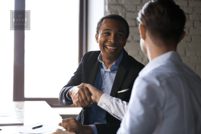 Happy client shaking hands with male professional