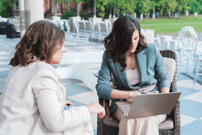 Wedding planners on laptop at event venue