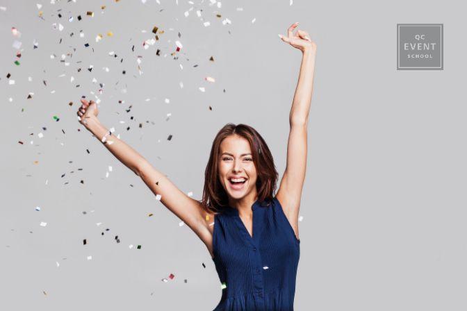 Woman celebrating, confetti in the air