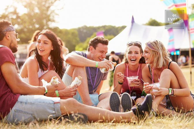Happy guests attending outdoor music festival