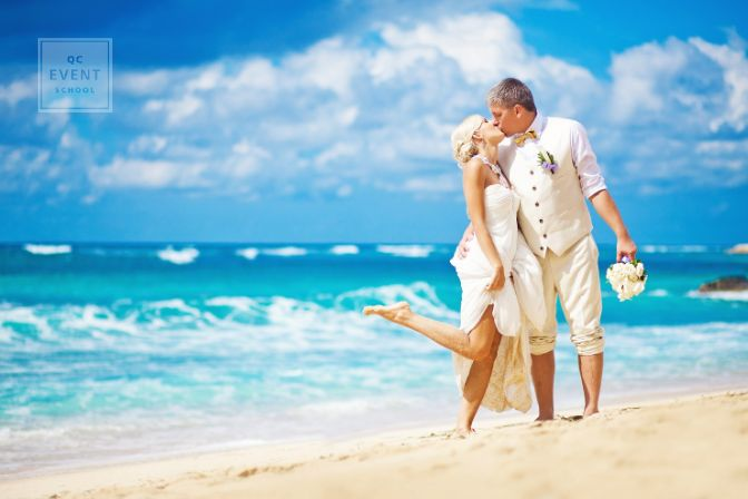 Sunny outdoor beach wedding, bride and groom kissing