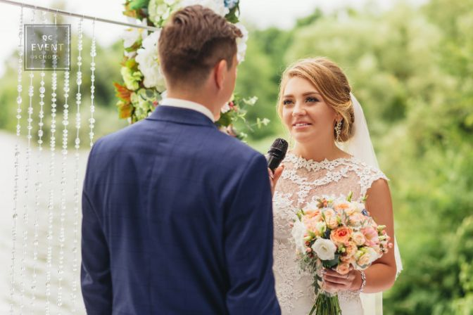 Bride exchanging vows with groom at wedding