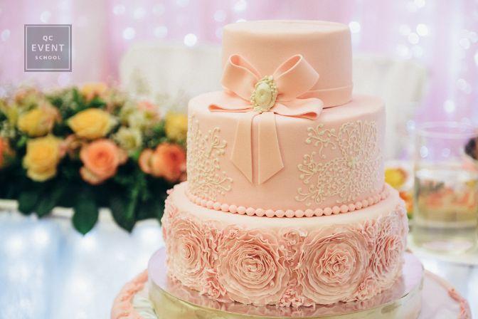 Beautiful peach-colored wedding cake