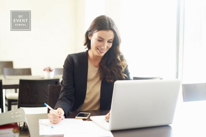 Shot of a beautiful young businesswoman using laptop and doing some paperwork while working on laptop.