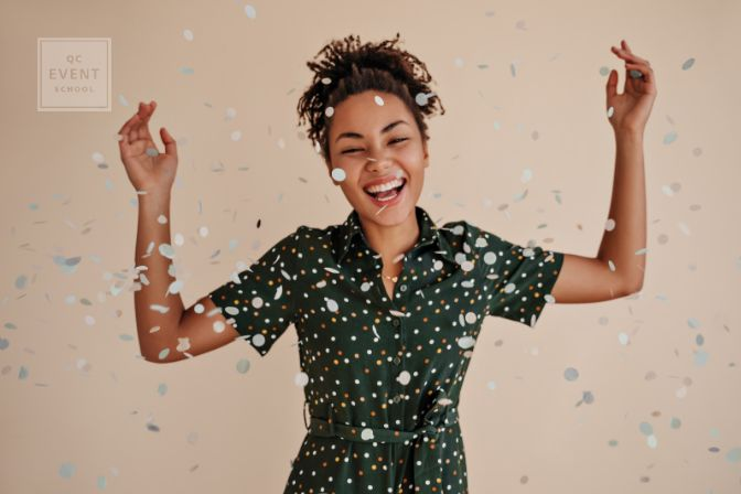 How to become a certified event planner article, July 16 2021, in-post image, woman celebrating with confetti in the air