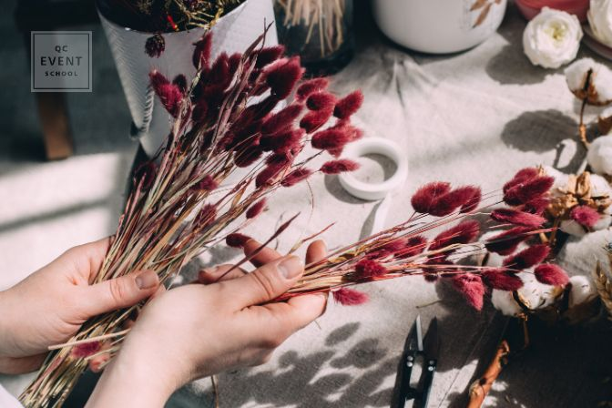 Florist making a bouquet of dried flowers