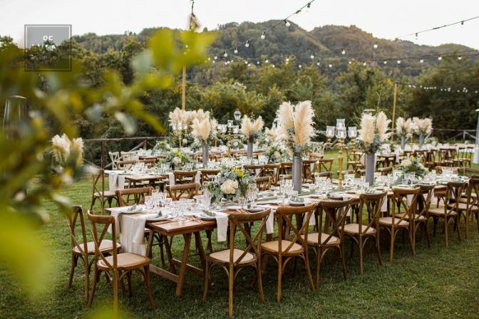 Wedding table set up in boho style with pampas grass and greenery, soft focus