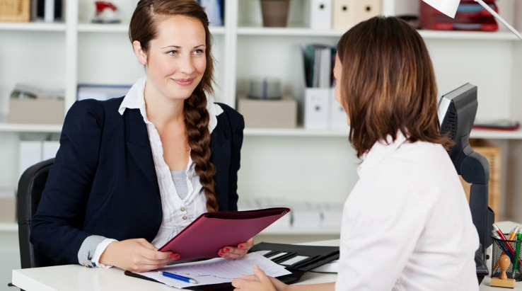 Small business owner conducting interview