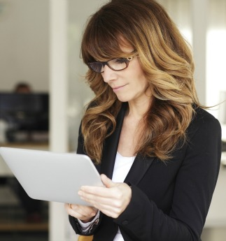Organized business woman on tablet