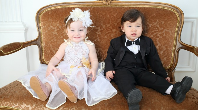 Girl and boy in bridal party dressed up for a wedding.