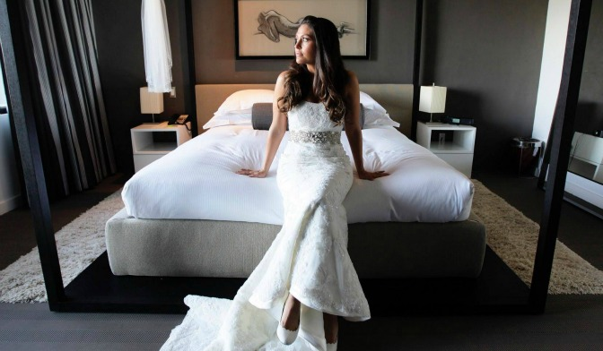 Bride posing in her dressing room