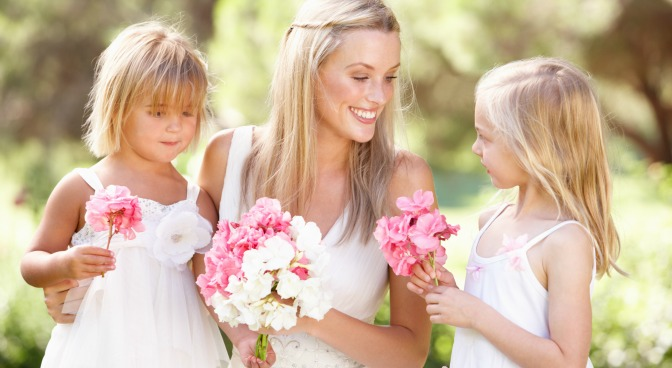 Bride with two young flower girls
