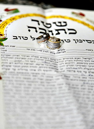Wedding bands on ketubah at Jewish wedding