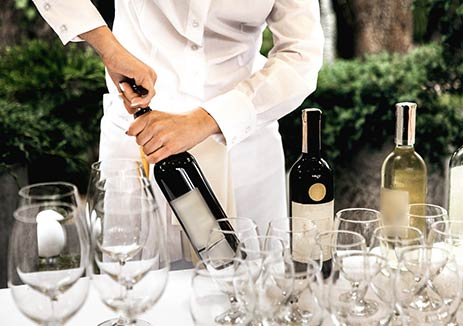Catering open bottle of wine at a private corporate event.