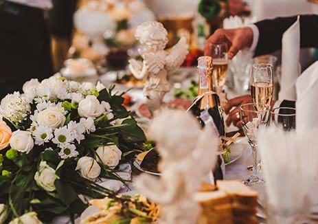 Luxourious Table Setting with Wine and Flowers