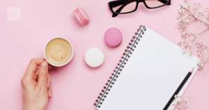 coffee notebook glasses and macarons